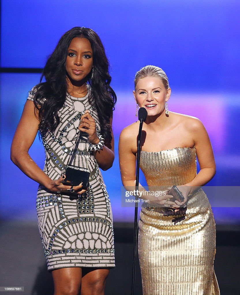 Kelly Rowland (L) and Elisha Cuthbert speak onstage at The 40th American Music Awards held at Nokia Theatre L.A. Live on November 18, 2012 in Los Angeles, California.