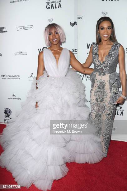 Kelly Rowland and Michelle Williams attend the Wearable Art Gala at California African American Museum on April 29 2017 in Los Angeles California