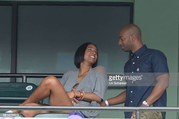 Kelly Rowland and Tim Witherspoon are seen at Sony Open Tennis at Crandon Park Tennis Center on March 29 2014 in Key Biscayne Florida