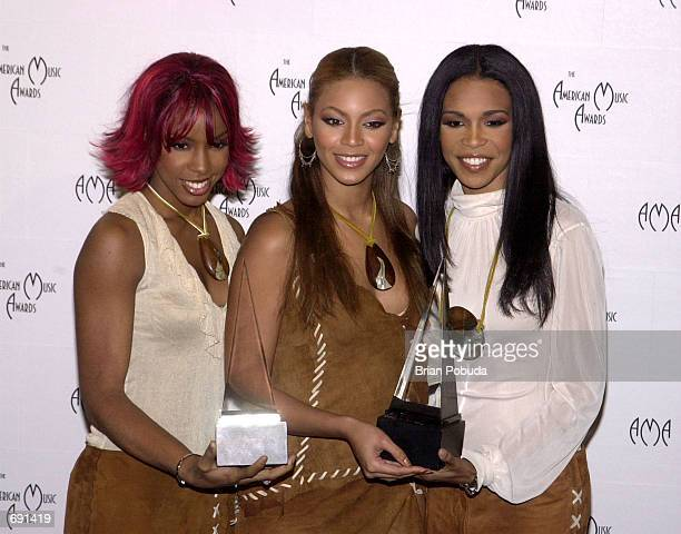 Kelly Rowland Beyonce Knowles and Michelle Williams of Destinys Child pose backstage during the 29th Annual American Music Awards at the Shrine...