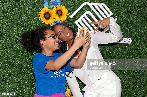 Kelly Rowland hosted by Claritin and the Boys Girls Clubs of America takes a selfie with India Daley during her visit to PS 64 on March 21 2016 in...
