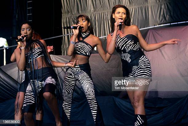 Kelly Rowland LeToya Luckett and Beyonce Knowles of Destiny's Child perform at Shoreline Amphitheatre on May 27 1998 in Mountain View California