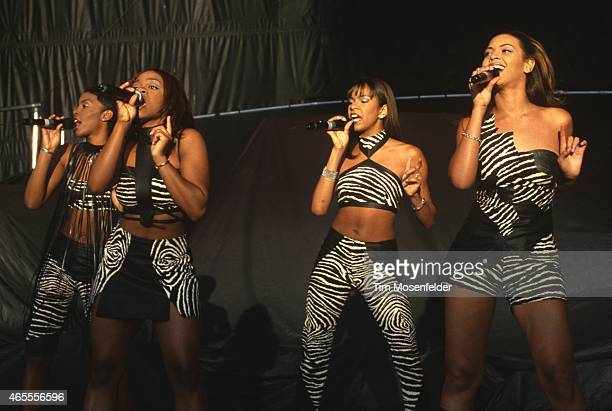 Kelly Rowland Michelle Williams and Beyonce Knowles of Destinys Child perform at Shoreline Amphitheatre on May 26 1998 in Mountain View California