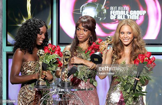 Kelly Rowland Michelle Williams and Beyonce Knowles of Destiny's Child accept their award for World's Best Female Group of All Time onstage at the...