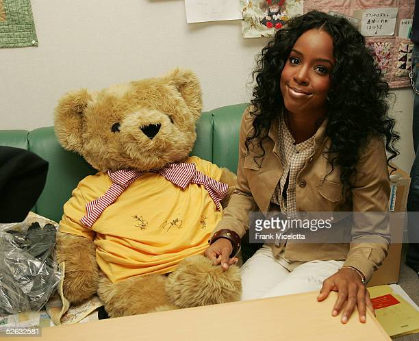 Kelly Rowland of Destiny's Child signs gifts during the bands visit to the Ronald McDonald House April 13 2005 in Setagaya district of Tokyo Japan...