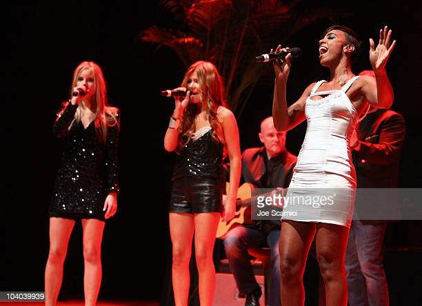 Kelly Rowland performs onstage with Ace of Base at the amfAR Cinema Against AIDS held at The Carlu during the Toronto International Film Festival on...
