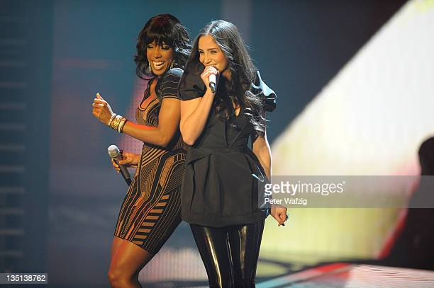 Kelly Rowland performs with Raffaela Wais during the 'The X Factor Live' TVShow Final on December 06 2011 in Cologne Germany