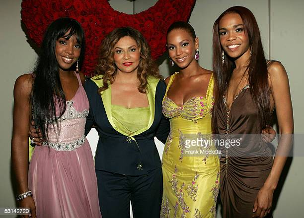 Kelly Rowland Tina Knowles Beyonce Knowles and Michelle Williams pose for a photo at the Beyonce Beyond the Red Carpet auction presented by Beyonce...