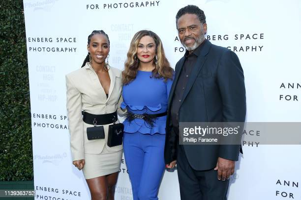 Kelly Rowland Tina Knowles Lawson and Richard Lawson attend the Annenberg Space For Photography's 10 year Anniversary Celebration and exhibit opening...