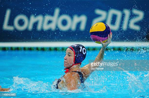 Kelly Rulon of the United States looks for a pass during the Women's Water Polo Preliminary match between Hungary and the United States on Day 3 of...
