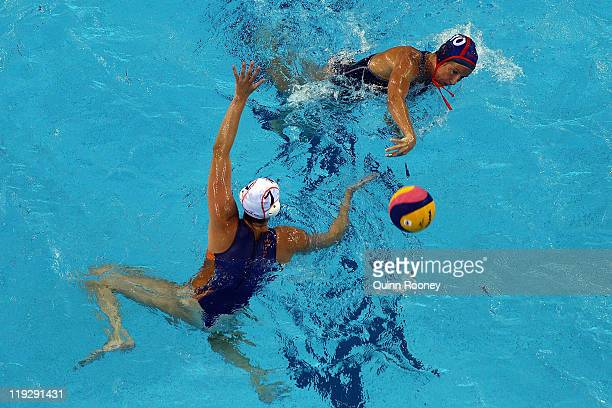 Kelly Rulon of the United States passes under a challenge from Iefke van Belkum of the Netherlands in the Women's Water Polo first preliminary round...