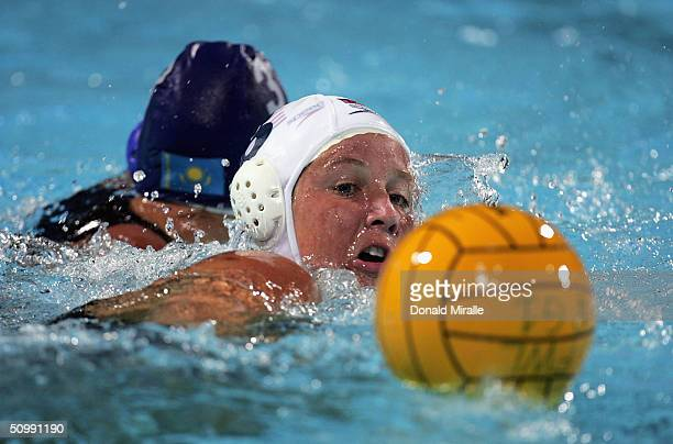 Kelly Rulon of the USA reaches for the ball against Tatyana Gubina of Kazakhstan during the 2004 FINA Women's Water Polo League Super Final on June...