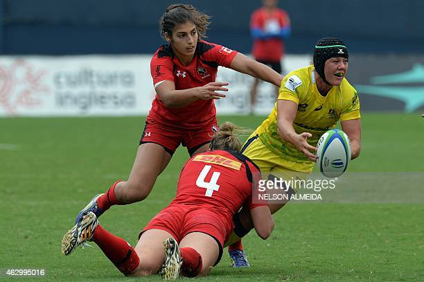 Kelly Russell of Canada tackles Sharni Williams of Australia during their IRB Women's Sevens World Series semi-final match against Canada in Barueri,...
