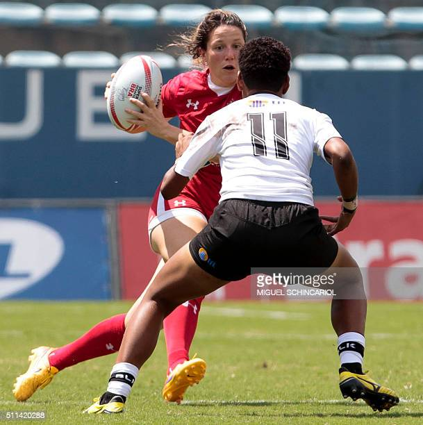 Kelly Russell of Canada tries to elude Miriama Naiobasali of Fiji during a World Rugby Women's Sevens Series match in Barueri some 30 km from Sao...