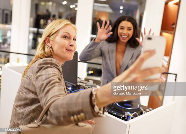 Kelly Rutherford and Hannah Bronfman take a selfie at the Patrick McMullan x Lafayette 148 New York Madison Avenue opening event at the Lafayette 148...