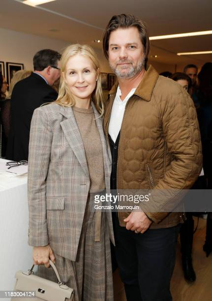 Kelly Rutherford and James Salomon attend the Patrick McMullan x Lafayette 148 New York Madison Avenue opening event at the Lafayette 148 New York...