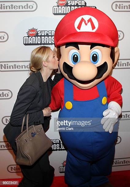 Kelly Rutherford and Mario attend the 25 years of Mario celebration Super Mario Bros Wii launch at the Nintendo World Store on November 12 2009 in...