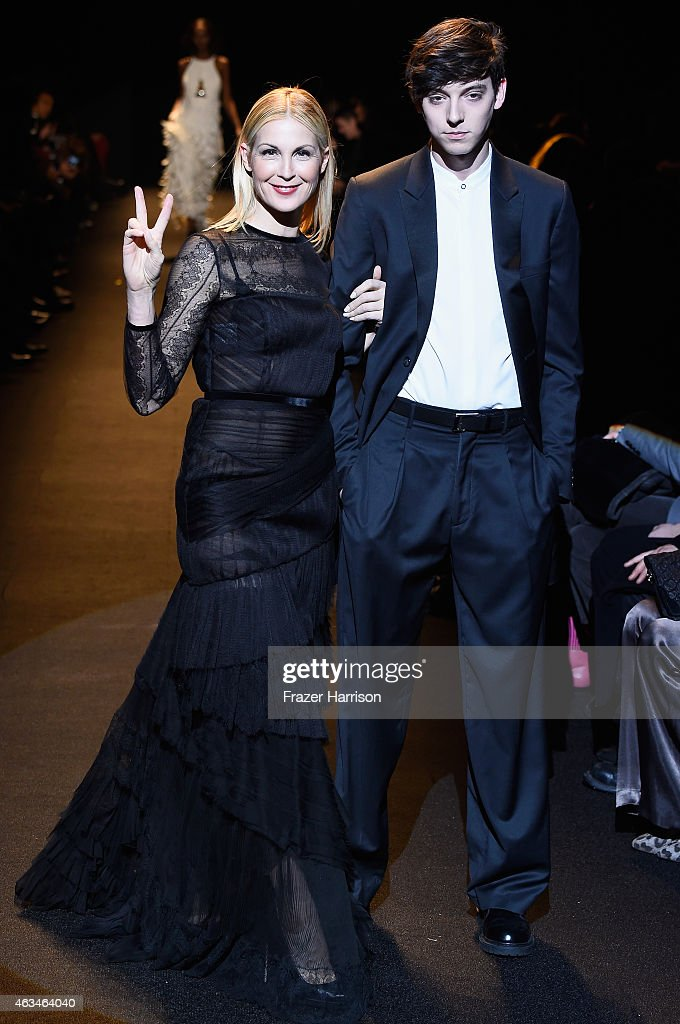 Kelly Rutherford (L) walks the runway at Naomi Campbell's Fashion For Relief Charity Fashion Show during Mercedes-Benz Fashion Week Fall 2015 at The Theatre at Lincoln Center on February 14, 2015 in New York City.