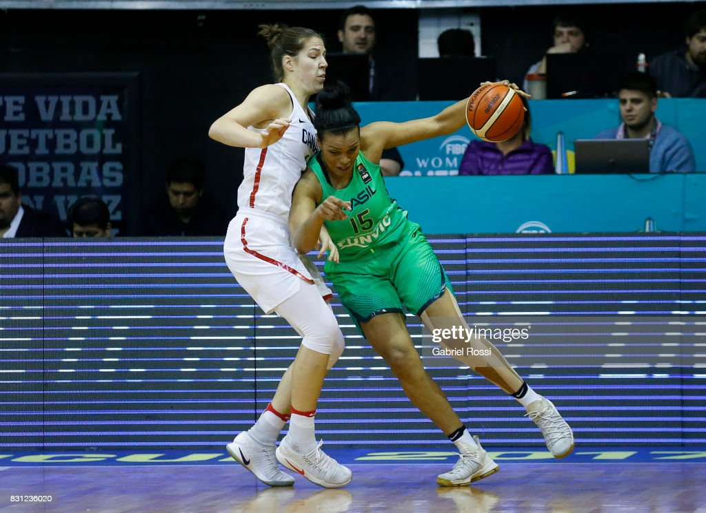 Kelly Santos of Brazil fights for the ball with Ruth Hamblin Canada during a match between Canada and Brazil as part of the FIBA Women's AmeriCup Semi Final at Obras Sanitarias Stadium on August 12, 2017 in Buenos Aires, Argentina.