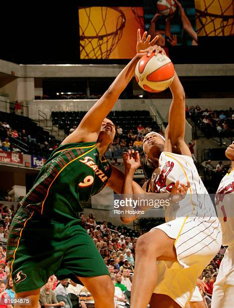 Kelly Santos of the Seattle Storm battles Tammy SuttonBrown of the Indiana Fever at Conseco Fieldhouse on July 18 2008 in Indianapolis Indiana The...