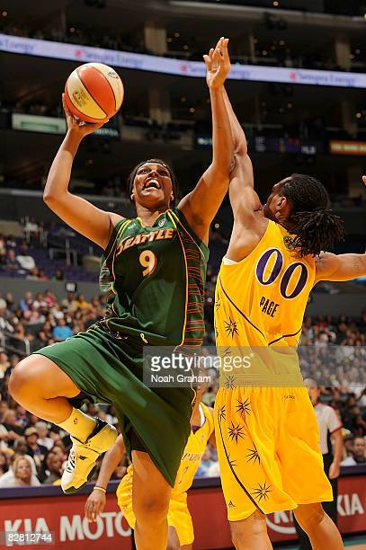 Kelly Santos of the Seattle Storm goes up for two points as Murriel Page of the Los Angeles Sparks block the shot on September 14, 2008 at Staples...