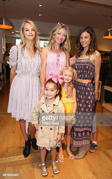 Kelly Sawyer Patricof Rebecca Gayheart and Norah Weinstein pose with children at the Baby2Baby Back To School Event at The Grove on July 22 2015 in...