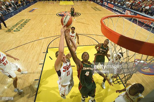 Kelly Schumacher of the Indiana Fever and Simone Edwards of the Seattle Storm battle for a rebound on June 28 2003 at Conseco Fieldhouse in...