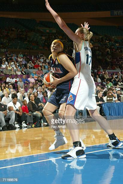 Kelly Schumacher of the New York Liberty guards against Tamika Whitmore of the Indiana Fever on June 13 2006 at Madison Square Garden in New York...