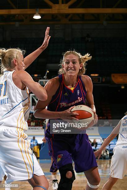 Kelly Schumacher of the Phoenix Mercury looks to pass while guarded by Cisti Greenwalt of the Chicago Sky during the WNBA preseason game on May 2...