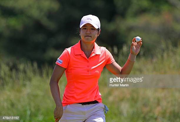 Kelly Shon waves to the crowd after putting out on the third hole during the final round of the ShopRite LPGA Classic presented by Acer on the Bay...
