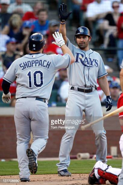 Kelly Shoppach of the Tampa Bay Rays is greeted by Johnny Damon as Shoppach heads toward the dugout after hitting a tworun home run in the in the...