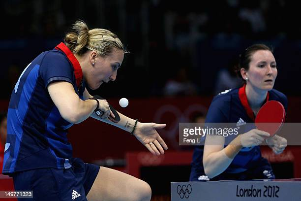 Kelly Sibley and Joanna Parker of Great Britain complete during Women's Team Table Tennis first round match against team of DPR Korea on Day 7 of the...