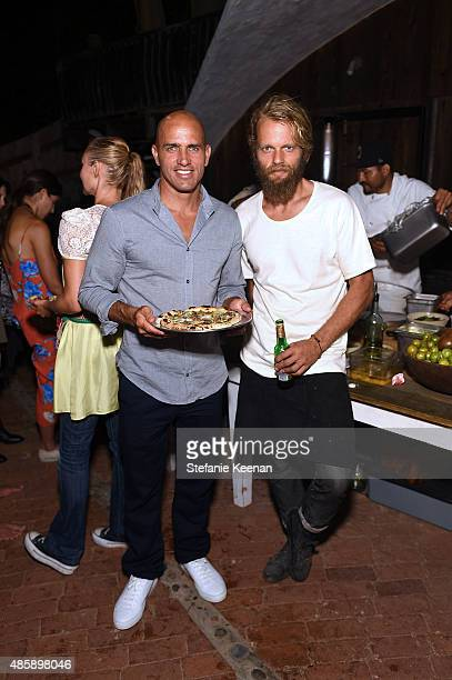 Kelly Slater and Travis Lett attend Kelly Slater John Moore and Friends Celebrate the Launch of Outerknown at Private Residence on August 29 2015 in...