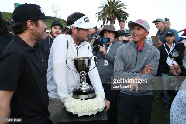 Kelly Slater chats with Bubba Watson at the 18th hole while waiting for the other groups to come up during the Celebrity Cup on February 10 2020 in...