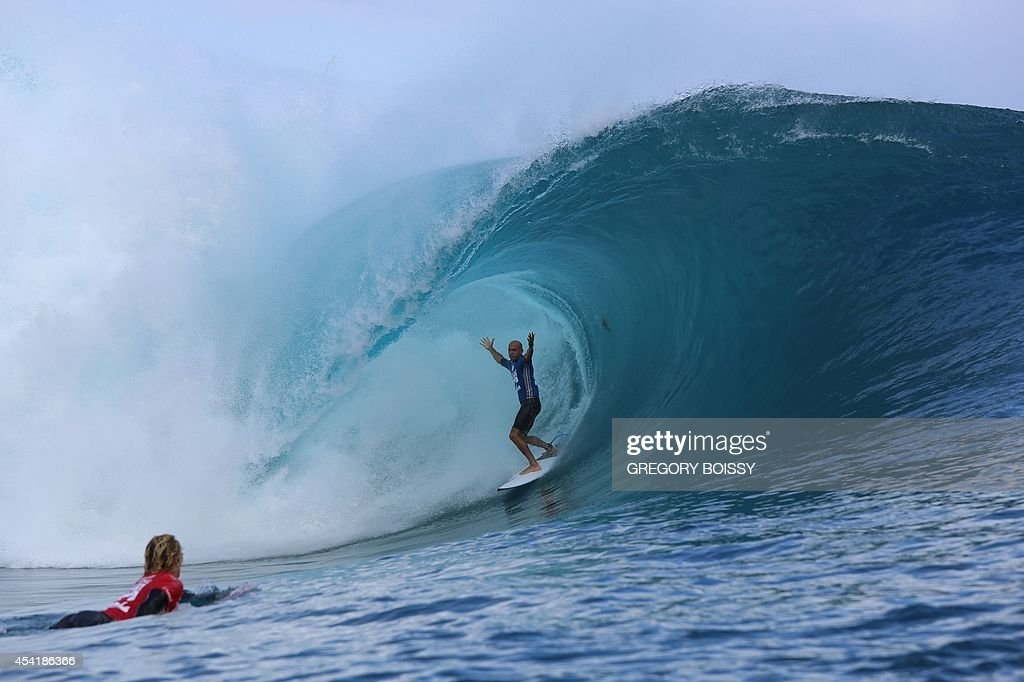 US Kelly Slater gestures after riding a wave during the finale of the 14th edition of the Billabong Pro Tahiti surf event, part of the ASP (Association of Surfing Professionals) world tour, on August 25, 2014 in Teahupoo, on the French Polynesian island of Tahiti. Brazil's Gabriel Medina won over US Kelly Slater.