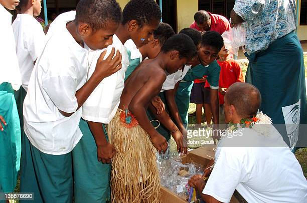 Kelly Slater hands out toys to village children during Kelly Slater Invitational Fiji Day 2 Mome Village Tour in Mome Village Tavarua Island Fiji