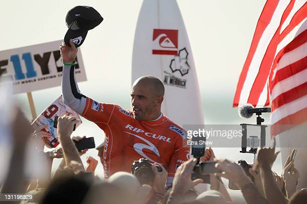 Kelly Slater is carried from the water after winning the 2011 ASP Men's World Title by winning his heat in round three of the Rip Curl Pro Search on...