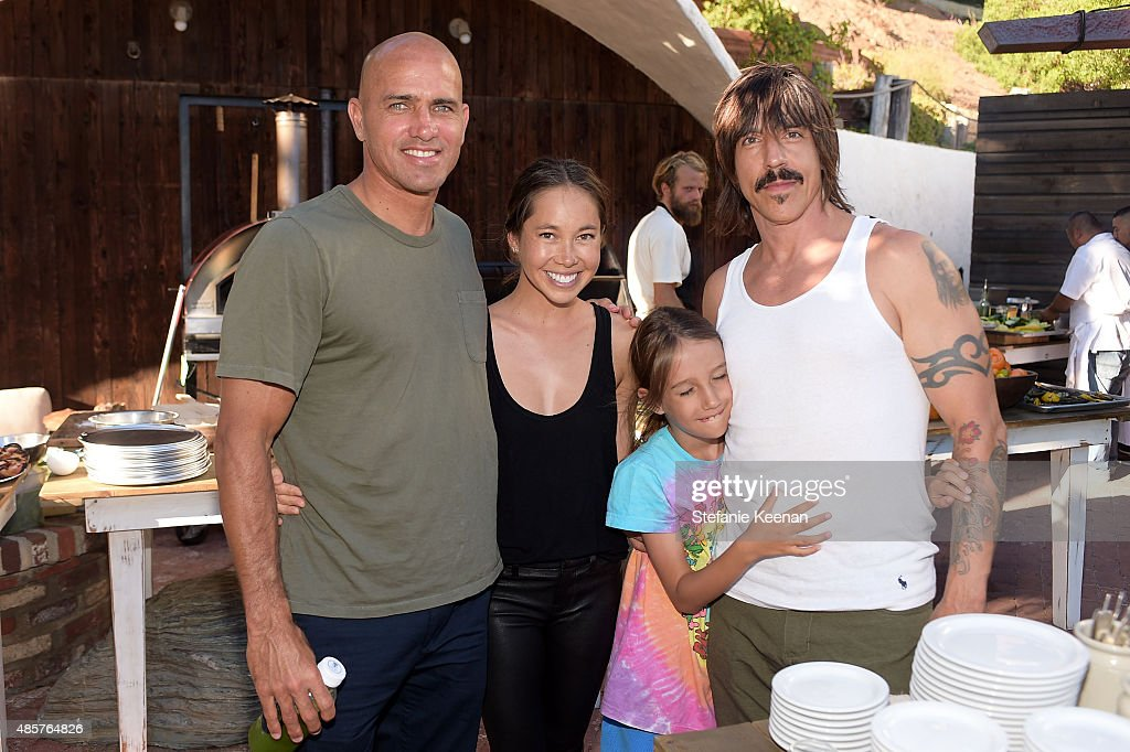 Kelly Slater, Kalani Miller and Anthony Kiedis attend Kelly Slater, John Moore and Friends celebrate the launch of Outerknown at Private Residence on August 29, 2015 in Malibu, California.