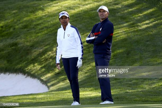 Kelly Slater of Team USA and Condoleezza Rice of Team USA look on during the celebrity challenge match ahead of the 2018 Ryder Cup at Le Golf...