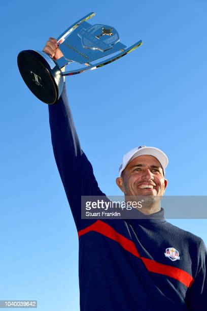 Kelly Slater of Team USA celebrates victory with the trophy after the celebrity challenge match ahead of the 2018 Ryder Cup at Le Golf National on...