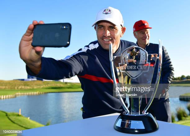 Kelly Slater of Team USA takes a selfie as he celebrates victory with the trophy after the celebrity challenge match ahead of the 2018 Ryder Cup at...