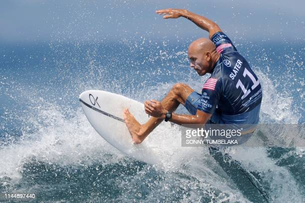 Kelly Slater of the US performs a manoeuvre on a wave during the World Surf League men's championship tour surfing event at Keramas in Gianyar on...