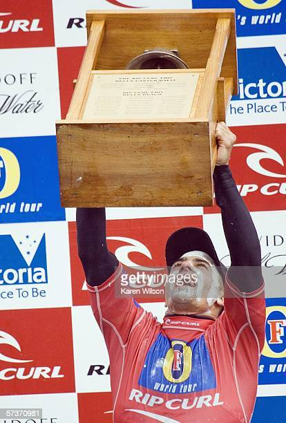 Kelly Slater of the USA celebrates with the trophy after his victory in the Rip Curl Pro on April 20 2006 at Bells Beach Australia