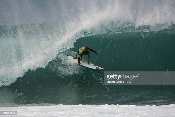 Kelly Slater of the USA competes at the RipCurl Pro WCT event at the Pipeline on the North Shore beaches of Oahu December 15 2006 in Honolulu Oahu...