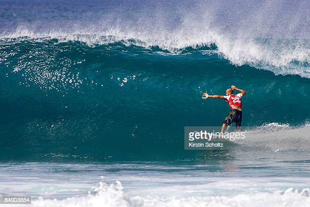 Kelly Slater of the USA competes in the Vans Triple Crown Of Surfing event the Billabong Pipeline Masters at Banzai Pipeline on December 10 2008 in...