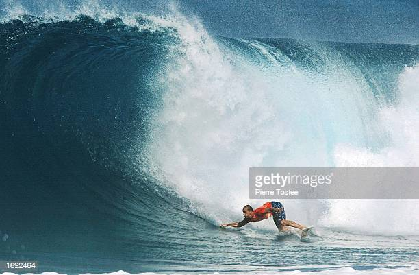 Kelly Slater of the USA drops into a wave on his way to third place in the Xbox Pipeline Masters at the Banzai Pipeline on the North Shore of Oahu...