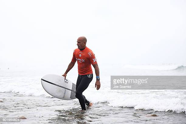 Kelly Slater of USA exits the surf after winning his third round heat at the 2016 Hurley Pro at Trestles at San Onofre State Beach on September 10...