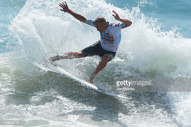 Kelly Slater of USA throws his tail off the top of a wave during the final heat against Yadin Nicol of Australia at the Nike US Open of Surfing on...