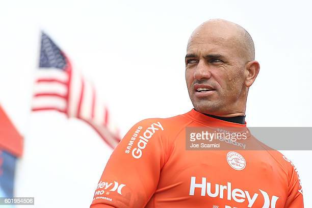 Kelly Slater of USA watches the surf after winning his third round heat at the 2016 Hurley Pro at Trestles at San Onofre State Beach on September 10...