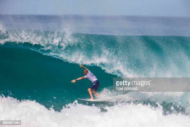 Kelly Slater pulls into the tube on 'Backdoor' during the 1st round of the Billabong Pipe Masters in Haleiwa Hawaii on December 11 2017 / AFP PHOTO /...